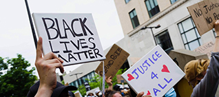 Hands holding Black Lives Matter sign